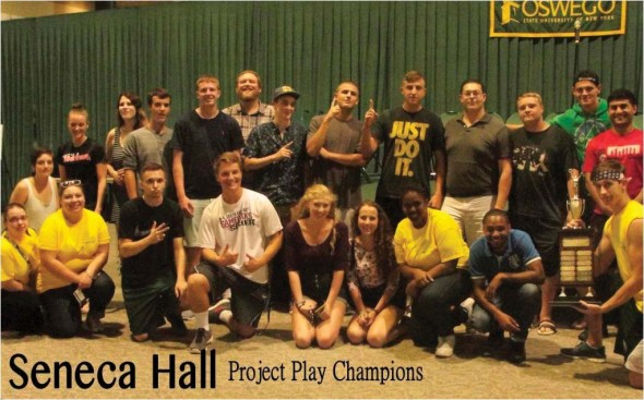 Residents of Seneca Hall, along with hall staff, pose for pictures with their championship trophy after being declared the winners of the 15th annual Project Play event that took place on Saturday, Aug. 23. The event involved all new students, including freshmen and transfers.  (Photo provided by Campus Recreation)