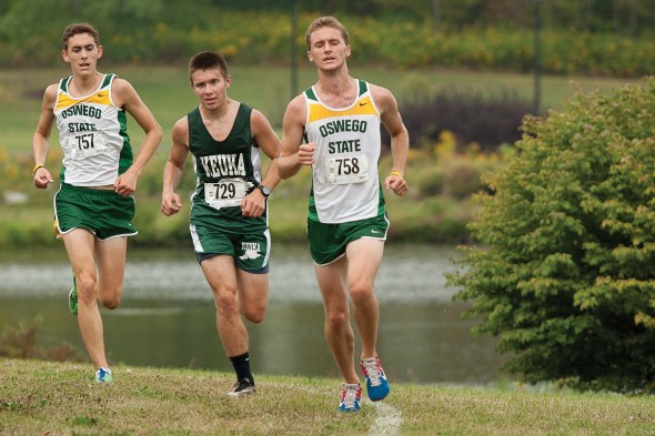 Captains senior Nick Montesano (left) and graduate student Nick Oetinger (right) take part in the Oswego State Invitational two seasons ago. The two leaders look to set the pace for a solid 2014 season.  (Photo provided by Chuck Perkins Photography)