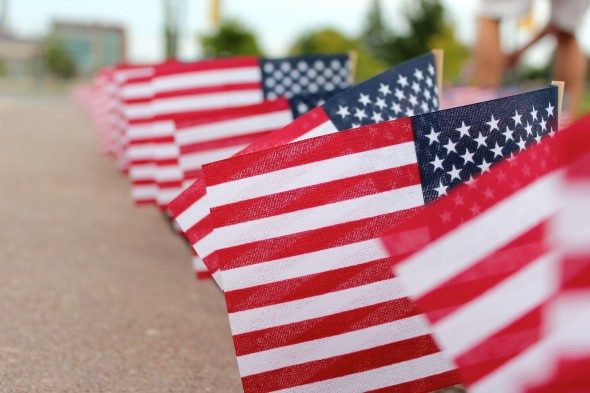 Nearly 3,000 flags flew by the entrance of Marano Campus Center Thursday to remember victims.  (David Armelino | The Oswegonian)