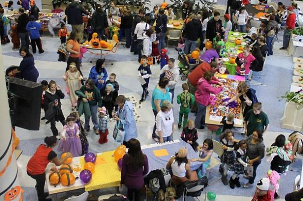 Young children and their families enjoy the festivities of  Safe Trick-or-Treat in the Marano Campus Center in 2012.  (Photo provided by Public Affairs)
