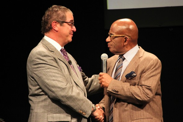 Media Summit founder Lou Borrelli '77 (left) honored by Al Roker '76 (right) for being awarded the Presidential Medal.  (David Armelino | The Oswegonian)