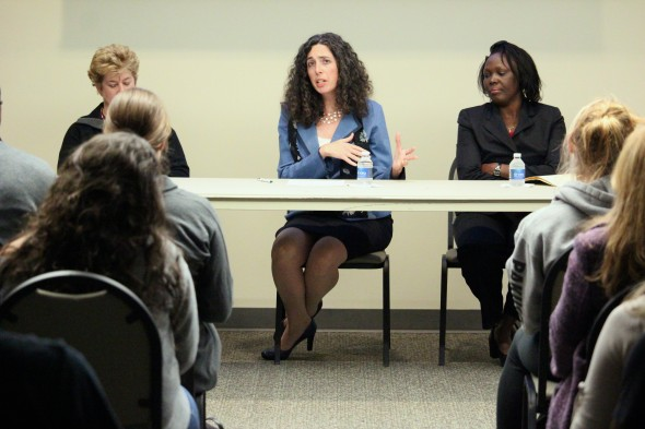 Diane Oldensburg (left), Gwen Kay  (center) and Dr. Sharon Ekure  (right) discuss Ebola virus.  (David Armelino | The Oswegonian)