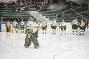 The Lakers line up for the national anthems before the game.  (David Armelino | The Oswegonian)