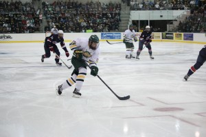 Sophomore transfer Joey Davies streaks through the circle during Saturday night's exhibition against the USA under-18 team. Davies finished the night with two goals (David Armelino   The Oswegonian).