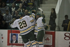 The Lakers celebrate after junior Brandon Adams' eventual game winner late in the second period on Saturday night (David Armelino   The Oswegonian).