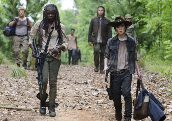 Danai Gurira and Chandler Riggs continue to survive and fight against hordes of the undead in season five of the smash horror hit.  (Photo provided by amctv.com)