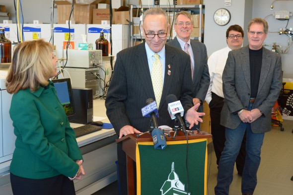 Oswego State President Deborah Stanley stands by Sen. Chuck Schumer at a press conference in Shineman.  (Photo provided by the Office of Public Affairs)
