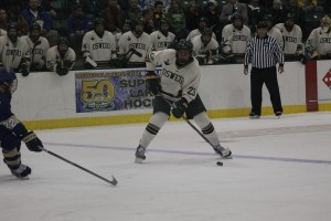 Oswego State sophomore defenseman Sean Federow picked up his first Laker goal to kick off the scoring on night one of 50th anniversary weekend. Federow's father, Art, played for the Lakers from 1978 to 1982 (Justine Polonski | The Oswegonian).