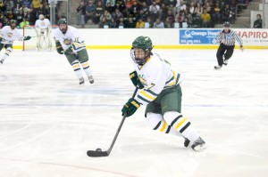 Freshman Mitch Herlihey streaks toward the College at Brockport net before beating Golden Eagles' goaltender Jared Lockhurst for the Lakers' second goal in a 4-4 tie on Friday night at the Marano Campus Center Arena. Herlihey has scored in three straight games and has five goals on the year (David Armelino | The Oswegonian).