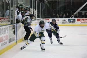 Oswego State freshman Mitch Herlihey streaks along the boards during Tuesday night's 2-1 loss to SUNY Geneseo at the Marano Campus Center Arena (Seamus Lyman | The Oswegonian).