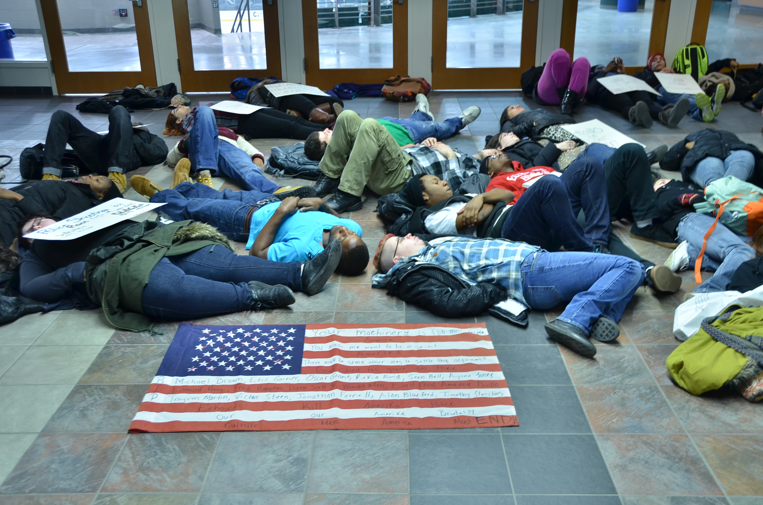 Students lie on the floor of the Marano Campus Center during a protest. (Alain Pierre-Lys | The Oswegonian)