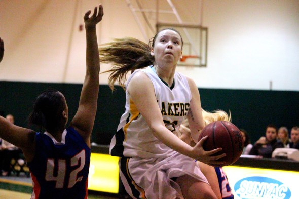 Laker guard Alisha Jacobs drives to the basket against New Paltz.