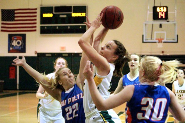 Oswego forward Heather Hebert goes up for a contested shot.