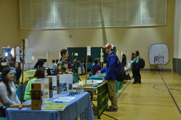 Students question organization opportunities from over 30 departments set up in the Swetman Gymnasium.  (JoAnn DeLauter | The Oswegonian)