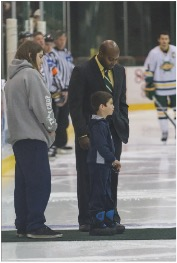 Ross' brother Braiden dropping the first puck. (Taylor Clock | The Oswegonian)
