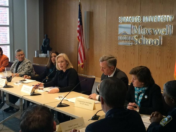 U.S. Sen. Kirsten Gillibrand (center), Rep. John Katko (right-center) and Syracuse Mayor Stephanie Miner (right) sit a roundtable discussion at Syracuse University.  (Photo provided by Sen. Gillibrand's Office)