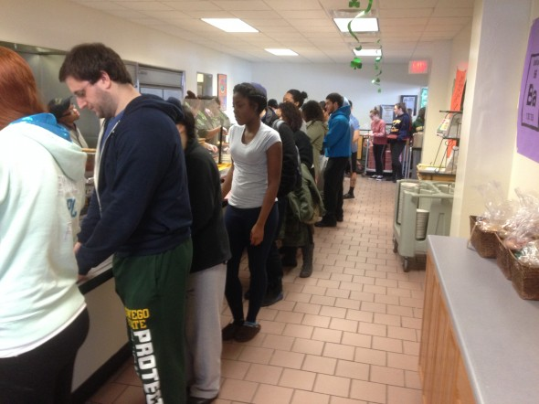 Students stand in line waiting for the various bacon delicacies at Pathfinder Dining Hall. (Photo provided by Chris Romita)