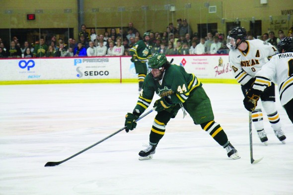 Sophomore Matt Galati (44) controls the puck in the offensive zone during the NCAA Quarterfinals on March 21 in Adrian, Mich. Galati had a goal in the 5-4 loss.  (Seamus Lyman | The Oswegonian)