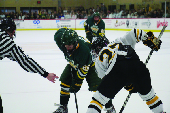 Sophomore Andrew Barton (26) takes a faceoff against Adrian College at  the Bulldogs' Arrington Arena.  (Seamus Lyman | The Oswegonian)