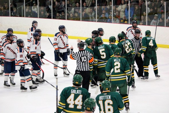 The two teams met at center ice following the second period after pushing and shoving in the Lakers' offensive zone and the Statesmen impeded Laker goalie Matt Zawadzki's path off the ice (David Armelino | The Oswegonian).