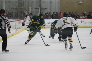 Oswego State sophomore Shawn Hulshof skates along the halfboards during Saturday night's NCAA Quarterfinals against Adrian College. Hulshof, the SUNYAC Player of the Year, tallied an assist in the contest to end the season with 42 points (Seamus Lyman | The Oswegonian).