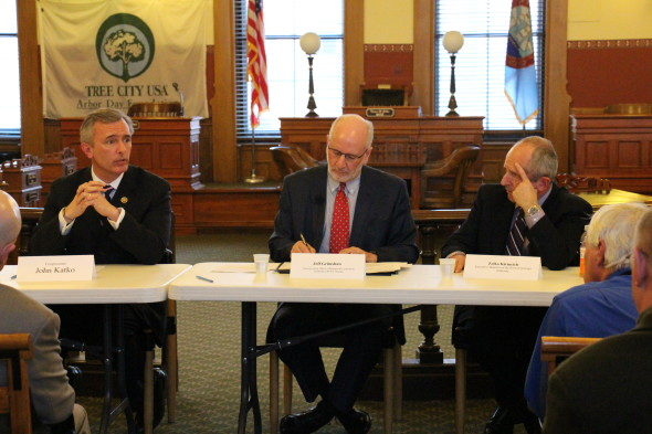 Rep. John Katko (left) speaks to attendees with Jeff Grimshaw (center) and Zelko Kirinciche (right) regarding economic development in Oswego County.  (Peter J. Hanley | The Oswegonian)
