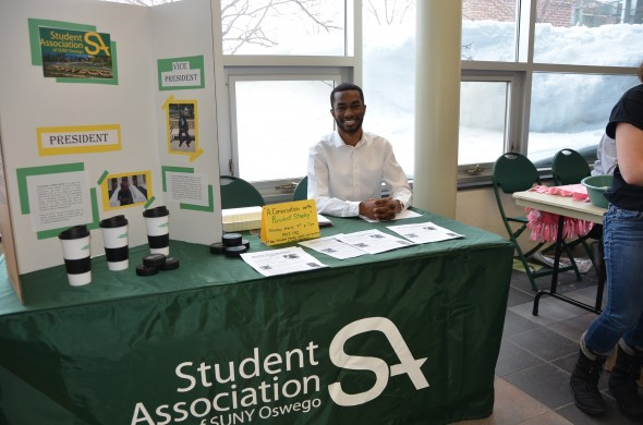 Presidential candidate Christopher Collins-McNeil tables for SA in the Marano Campus Center prior to the election.  (JoAnn DeLauter | The Oswegonian)