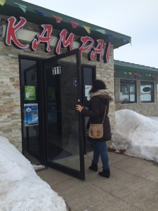 A student patron entering Kampai Hibachi Steakhouse.