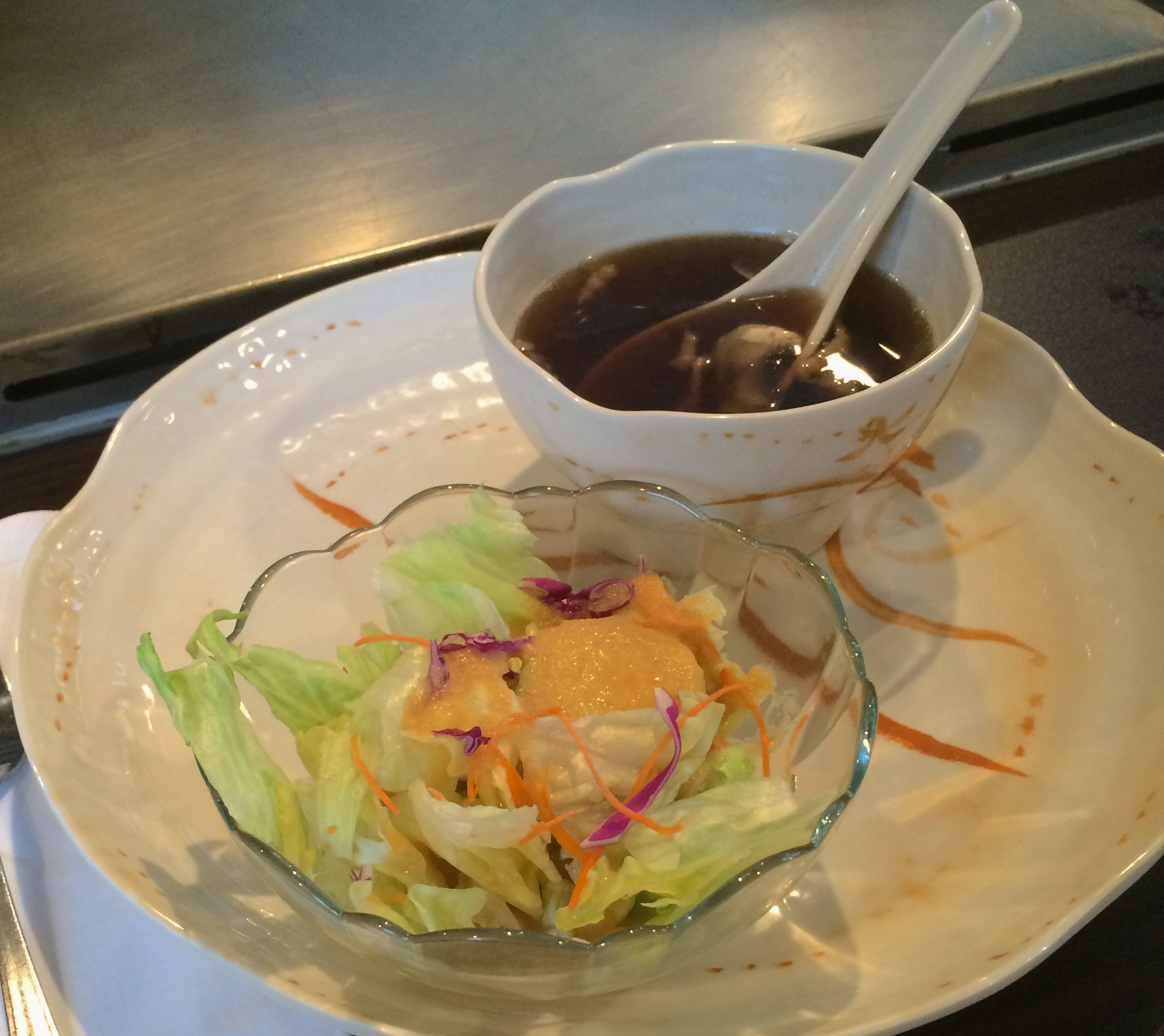 Ginger salad and miso mushroom soup is served as an appetizer.  (Photo provided by Christina Madera)