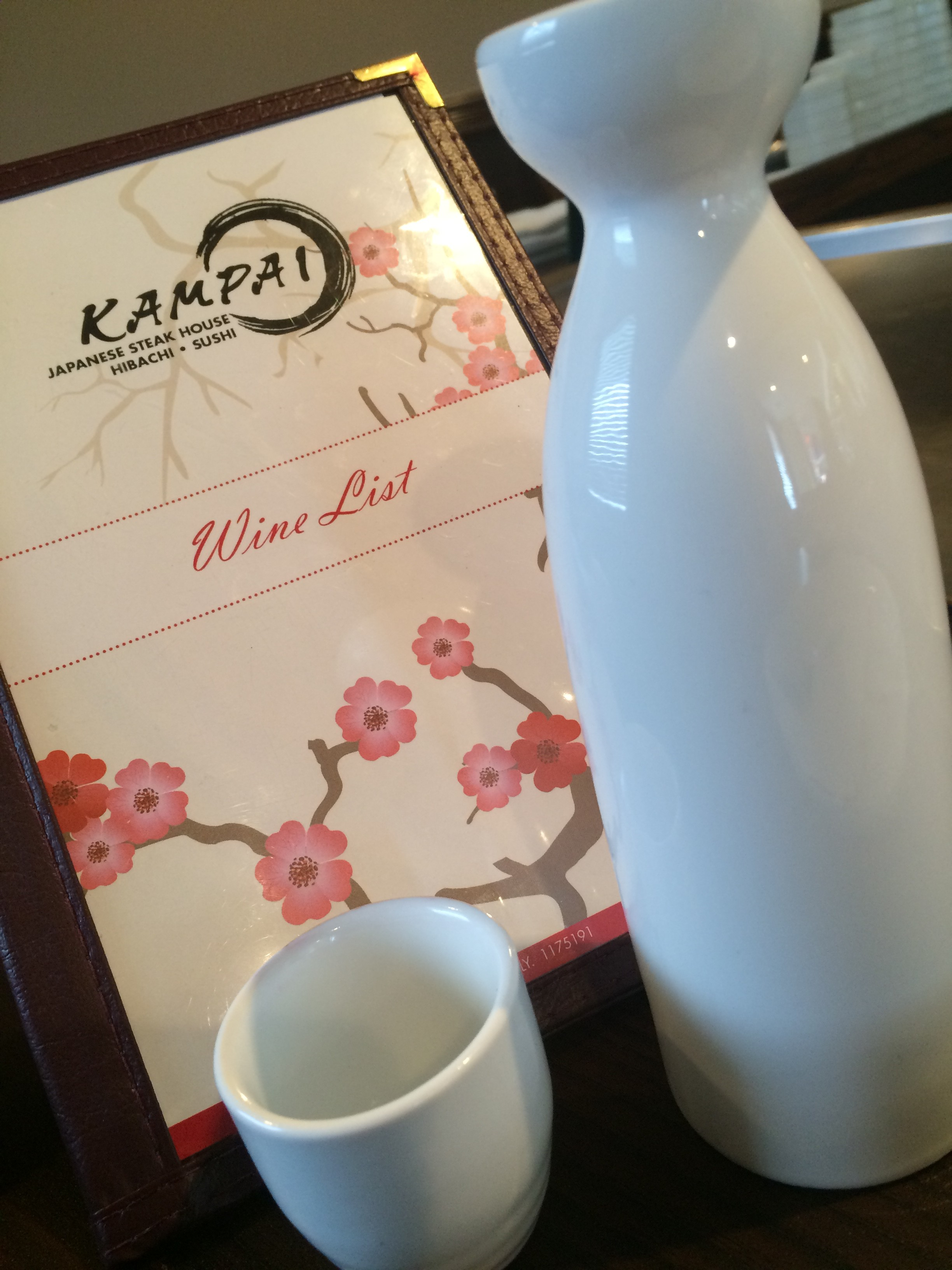 Kampai's wine list and sake dishes. (Photo provided by Christina Madera)