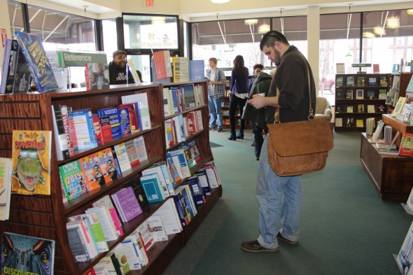 Oswego State students and local citizens shop for books at the River's End Bookstore on April 9. (Katie Ports | The Oswegonian)