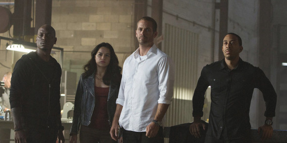 Paul Walker's (center) tribute in 'Furious 7' was deftly handled, while still managing to pack in amazing stunts and action. (Photo provided by furious7.com)