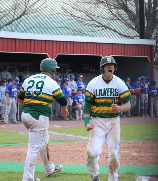 Dan Saccocio celebrates after scoring a run to extend Oswego State's lead. (Seamus Lyman | The Oswegonian)