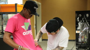 Mac Miller signed fans shirts during a backstage meet and greet.
