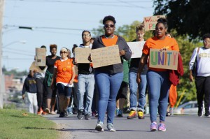 Students come together to walk and chant through Oswego City encouraging peaceful diversity and unity on campus as well as in the community.  (Alexander Simone | The Oswegonian)