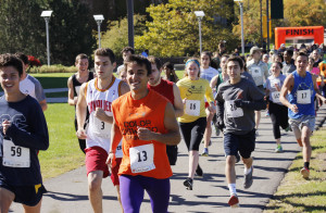 175 runners started at the 5K at the Marano Campus Center toward the Shineman Science Center, around lakeside and finishing in the academic quad on oct. 10  (Alexander Simone | The Oswegonian)