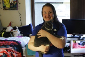 Maegan Kenny lives with her cat, Foxy, to make her feel more at home in her residence hall, Riggs. (Alexander Simone | The Oswegonian)