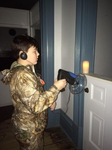 13-year-old local resident and tour guide for the fort, tests out some equipment that ghost hunters use (Mia Sampson l The Oswegonian)