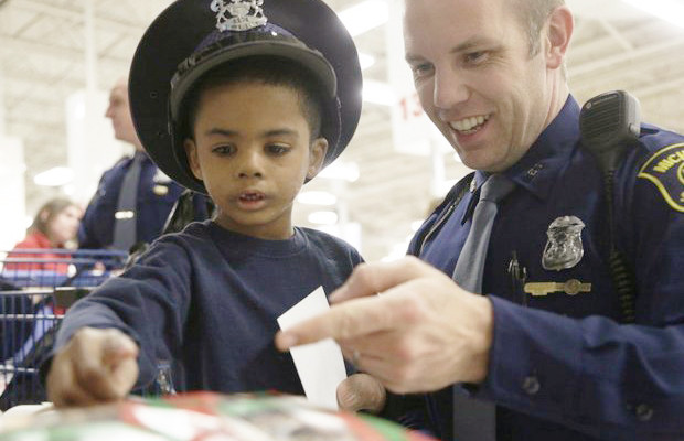 Officers reach out to help community members and establish better trust between citizens and law enforcement. (Phot provided by Charlotte Gilhooly via wikipedia)