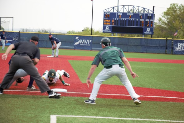 Eli Holton slides into third base safely for a triple to extend the Lakers lead to 3-0 in the first inning. (Cole Parzych | The Oswegonian)
